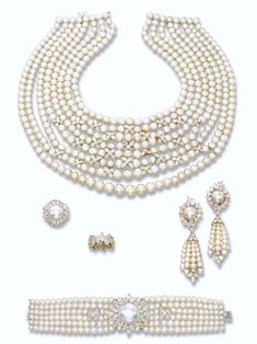 MAGNIFICENT AND HIGHLY IMPORTANT NATURAL PEARL AND DIAMOND PARURE, BY GÉRARD INCLUDING AN EXCEPTIONAL BUTTON-SHAPED NATURAL PEARL AND A DIAMOND ETERNITY RING