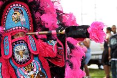 A Spy Boy with the Mohawk Hunters Mardi Gras Indians tribe parades