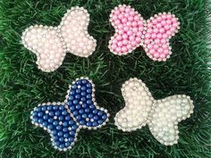 borboletas  com pérolas e stras Mãos de Fada Artesanato  www.facebook/ mfmuzambinho
