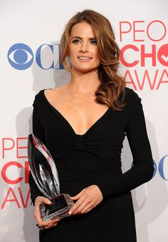"""Stana Katic Photos Photos - Actress Stana Katic poses with Favorite TV Crime Drama for """"Castle"""" in the press room during the 2012 People's Choice Awards at Nokia Theatre L.A. Live on January 11, 2012 in Los Angeles, California. - 2012 People's Choice Awards - Press Room"""