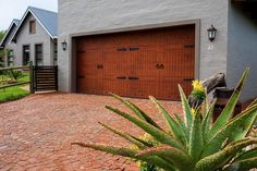 Van Acht Garage Doors for single garages as well as double garages. We also manufacture an extra height garage door for caravans. Garage Door Opener, Garage Doors, Extension Springs, Double Garage, Windows And Doors, Bricks, Nairobi, Costco, Confused