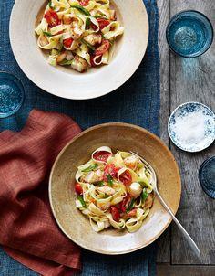 Fettucini with shrimp cherry tomatoes and basil
