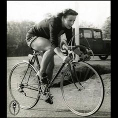 This photograph captures the petite yet immensely powerful 4 foot 11 inch Eileen Sheridan in the 1950's on her Hercules bicycle.