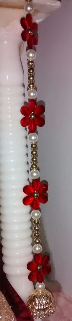 Flower Latkan/Strings - Big red acrylic flowers put in a string of white pearls…