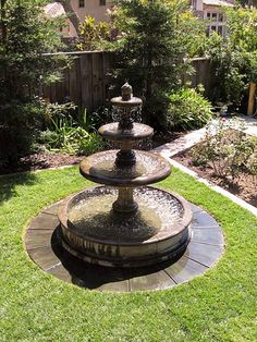 tiered outdoor water fountain with pool