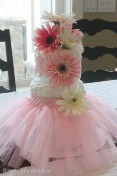 Simply This and that: Baby Girl Shower.  Diaper Cake with Tull Skirt and Flower Headbands.