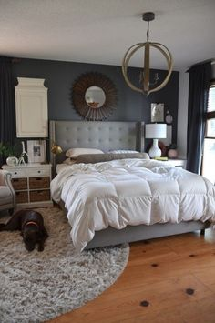 large and even mismatched bedside tables, rug off center, accent chandelier