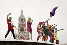 "Pussy Riot shouts ""Revolt in Russia, Putin's got scared!"" in one of their punk performances atop a platform in Moscow's iconic Red Square"