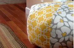 Love the overstuffed round pouf pillows, but can't drop alot to buy one? Here's how to make one.