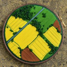 Wow, I just love this embroidery hoop piece featuring farmland fields with interspersed trees in shades of green, yellow, and brown. Such a unique and creative piece! Embroidery Hoop Art, Cross Stitch Embroidery, Embroidery Patterns, Hungarian Embroidery, Embroidery Jewelry, Fabric Art, Oeuvre D'art, Cross Stitching, Textile Art