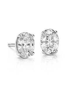 These diamond stud earrings feature oval, near-colorless diamonds set in 14k white gold (1 ct. tw.)