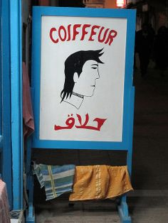 Sign for a hairdresser in Morocco Barber Sign, What's So Funny, International Signs, Afro Art, Hand Painted Signs, Shop Signs, Morocco, Signage, Pin Up