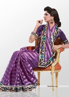 Simple and sober pattern designer purple shade saree. Shiny satin patti patch and heavy embroidery gives it trendy look. It will look good for evening parties. http://goodbells.com/saree/shiny-purple-shade-saree.html