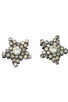Sparkly vintage earrings in the shape of stars.