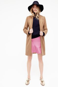 J.Crew Looks We Love: women's Regent topcoat, Aran Crafts™ cable turtleneck, flutter mini skirt, wide-brimmed felt hat with leather band and Biella mirror metallic loafers.