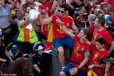 Arbeloa holds theEuropean Championship trophy aloft on a victory parade…