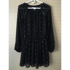 Urban outfitters dress Black dress with white polka dots. Size XS. In amazing condition. Really classy and cute and also has two open slits by the neckline. Urban Outfitters Dresses