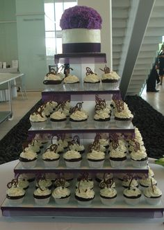 Cupcake Wedding Cake! Add Some Royal Purple and Blue in place of the white!