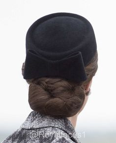 The Duchess accessorized with a new hat, a pillbox style with a vintage feel and netting that covered her updo. Perhaps Lock & Co Betty Boop hat ?