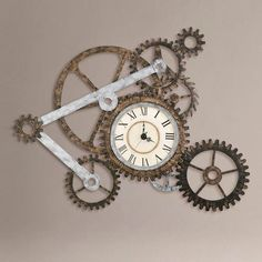 by World Market  Gear Wall Art with Clock - $149.99  This is a pretty interesting clock for the engineer in everyone. I love the antique look too.