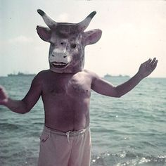 Pablo Picasso fooling around on the beach with his favorite bull head. Found here.