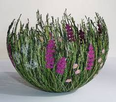 Anne Honeyman (http://www.annehoneyman.co.uk) - This textile artist makes these bowls entirely from thread. This bowl is part of her Cottage Garden series.