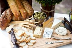 Yummy appetizers and finger foods like olives, cheese and loaves of bread are not only great to nibble on while dinner is being made, but they also add a rustic touch to any table, via: