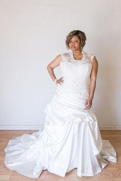 Plus size wedding gowns with cap sleeves cover teh top part of the shoulder.  This fit-and-flare style bridal gown can be recreated in any size and with any changes.  (We can also create a replica of any haute couture #weddingdresses for less if you are on a budget.)  See more plus size wedding dresses with sleeves at www.dariuscordell.com