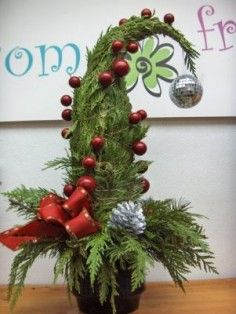 GRINCH TREE Arrangement in Calgary, AB - FIRST CLASS FLOWERS LTD.