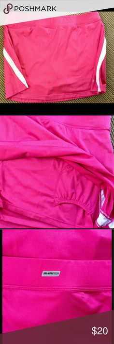 DANSKIN NOW SZ L Pink Tennis Skirt w/Shorts💕NWOT DRI-MORE TECH Pink & White Tennis skirt with attached shorts....skort! Never worn. Size Large...12-14. NWOT. Danskin Now Skirts