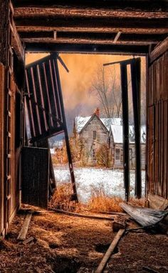 Abandoned Old Farm House As Seen Through The Eyes Of The Barn Doors