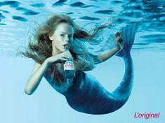 a mermaid drinking evlan