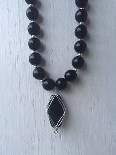 A personal favorite from my Etsy shop https://www.etsy.com/listing/514490220/black-and-silver-necklace-black-necklace