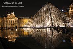Musée du Louvre at night, Paris France