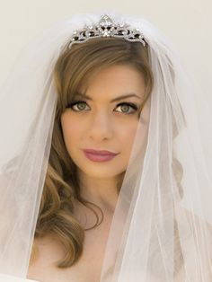 Small vintage inspired rhinestone and pearl bridal princess tiara comb with veil by Hair Comes the Bride.