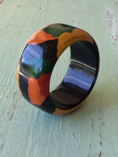 A personal favorite from my Etsy shop https://www.etsy.com/listing/289687553/vintage-wood-bangle-multi-color-bangle