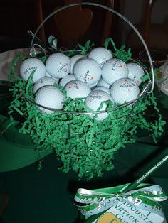 Golf Themed Party Ideas for Father's Day — You may have to borrow a wire bucket from your local driving range to make this centerpiece from EtiquetteMiss Janice. I really like the crimped paper grass, but Easter grass would also work. #fathersday #partyideas #centerpiece #golftheme