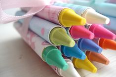 """Darling favor!  Bundle up a small bunch of """"custom crayons"""" and tie them with some pretty ribbon."""