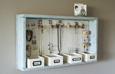 DIY Jewelry Organizer - a pretty place to display and organize jewellery Instead of having hooks on the wall, they are all inside the box.  like it!