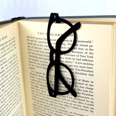 Glasses bookmark. Die cut and Engraved Brass.