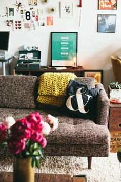 Love the couch, throw, ampersand pillow, table with peonies.