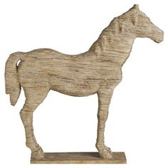 Rustic and artful, this wood horse-shaped decor brings farmhouse style to any space.   Product: DecorConstruction Ma...
