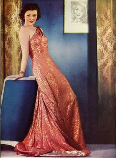 Myrna Loy in a slinky, shimmery, one shouldered number.