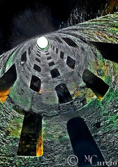 St. Patrick's Well  in the village of Orvieto, Italy by Mario Curcio