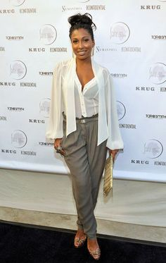 #8. Melanie Fiona Who: Melanie FionaWhere: Shine On Sierra Leone Fundraiser in Venice, CA Why: Hitting a few of-the-moment trends with her neutral pieces, her mesh top and tapered pants, Melanie Fiona is giving me trendy bombshell. She kept it sophisticated yet fun. And let's not forget about that amazing top knot. Work!