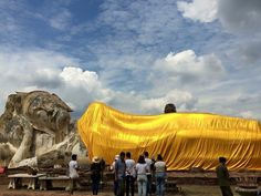 Wat Lokkayasutharam, Ayutthaya, Thailand — by Sabrina Gunn. The Giant Reclining Buddha on the outskirts of Ayutthaya is absolutely stunning and with the contrast of the gold on...
