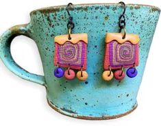 Angie Wiggins brings us back to reality with her down-home earrings on PolymerClayDaily.com Insect Eggs, Happy Birthday Hearts, Jewel Tone Colors, Funky Earrings, Back To Reality, Things Under A Microscope, Resin Coating, Pinwheels, Polymer Clay Jewelry