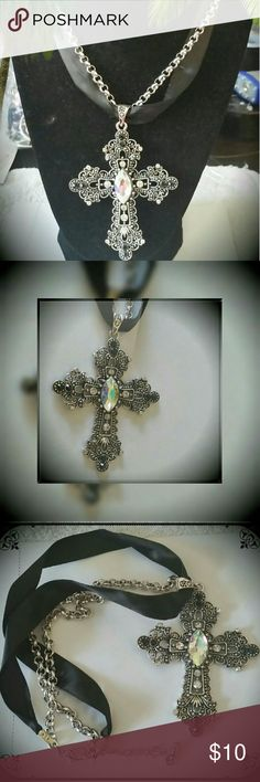 """Filigree Cross Necklace Authentic Swarovski Navette Clear Crystal Pendant  Authentic Swarovski Jet Crystals Cross Pendant Measures Approx. 3""""  Finish Adjusts From 16""""-18 1/2""""  Finishes on a Ribbon/Rolo Chain  Inspirational Collection Piece   A stunning cross pendant dangles from a ribbon chain with a beautiful Navette Clear Crystal Pendant centerpiece surrounded by Swarovski Jet Crystals and glittering clear rhinestones.   The Navette Crystal Pendant was inspired by famous fine jewelry cuts…"""