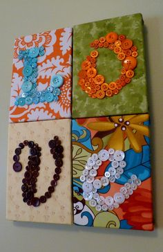 "Show your love in buttons with this one-of-a-kind wall hanging. As with all my button creations, I do not use glue. Each button is sewn into place by hand. I then attach the fabric and button letter to a 5""x7"" canvas and join them together. This wall hanging measures approximately 10""x14""."