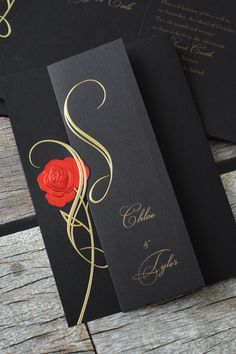 Guests will find themselves absolutely spellbound by these gorgeous wedding invitations. The invitation folds and tucks beneath the elegantly embossed rose, which is created with shimmering red and gold foil.